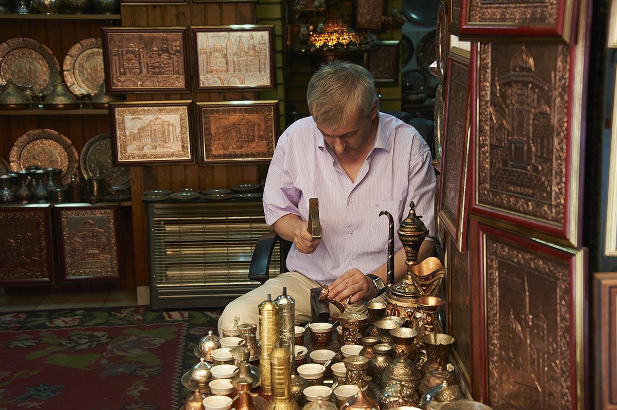 Copper master at Coppersmith street in Sarajevo