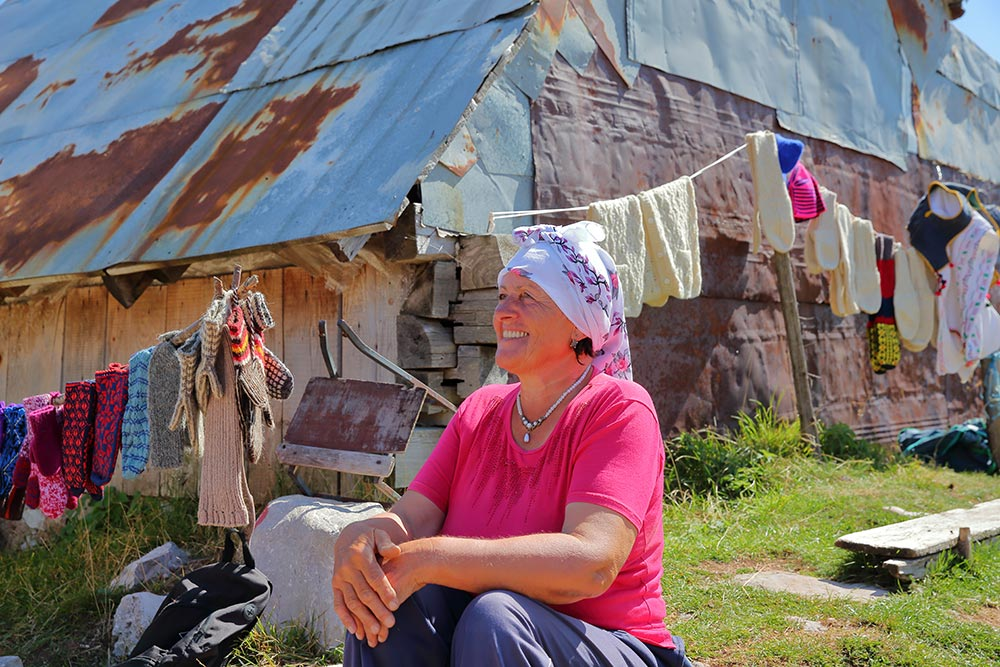 Lady at Umoljani village selling local products - Bjelasnica mountain, Bosnia and Herzegovina