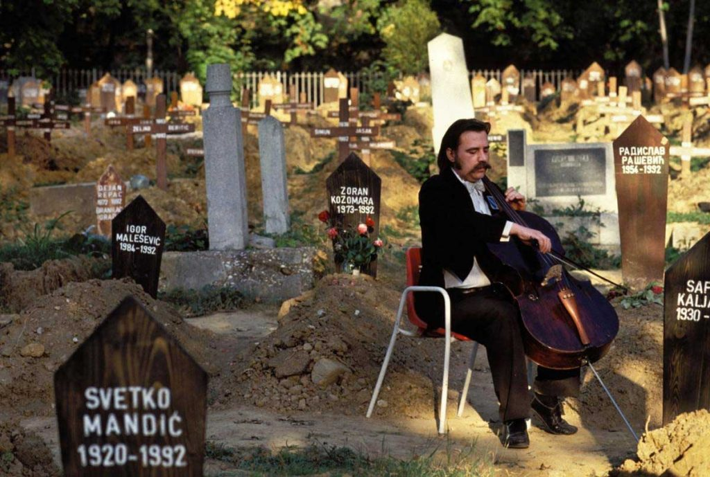 Vedran Smalovic, a cellist, playing a requiem for the for the victims of Siege of Sarajevo at Lav Cemetery