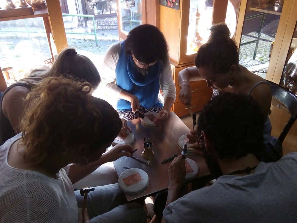 Group working on their coppersmith workshop in Sarajevo