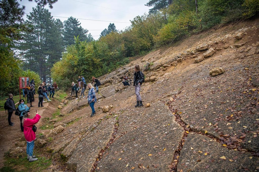 Tourists exploring the surface of the Bosnian Pyramid of the Sun