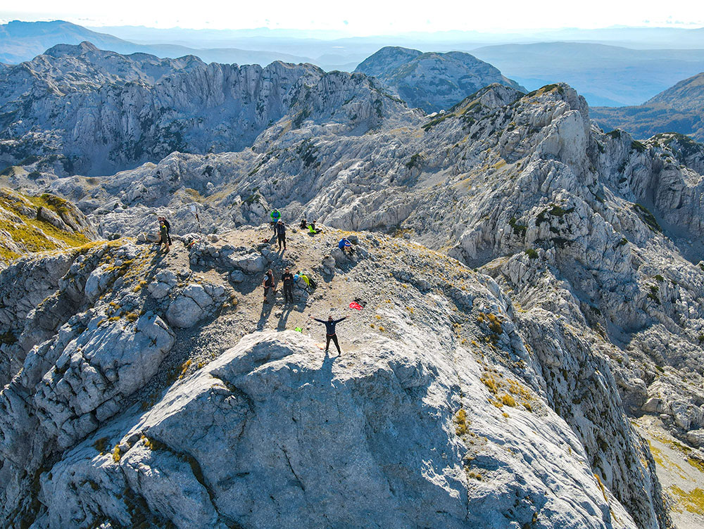Group of Funky Tours hikers enjoying their time at the peak of Prenj - Zelena glava at 2155m