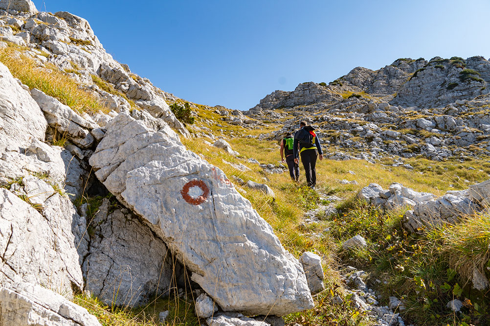 Mountaineers climbing the region of Prenj just before starting main climb to Zelena glava peak
