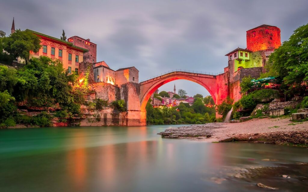 Mostar Old Bridge during the sunset makes the experience of visiting Mostar during the evening hours the best time to be.